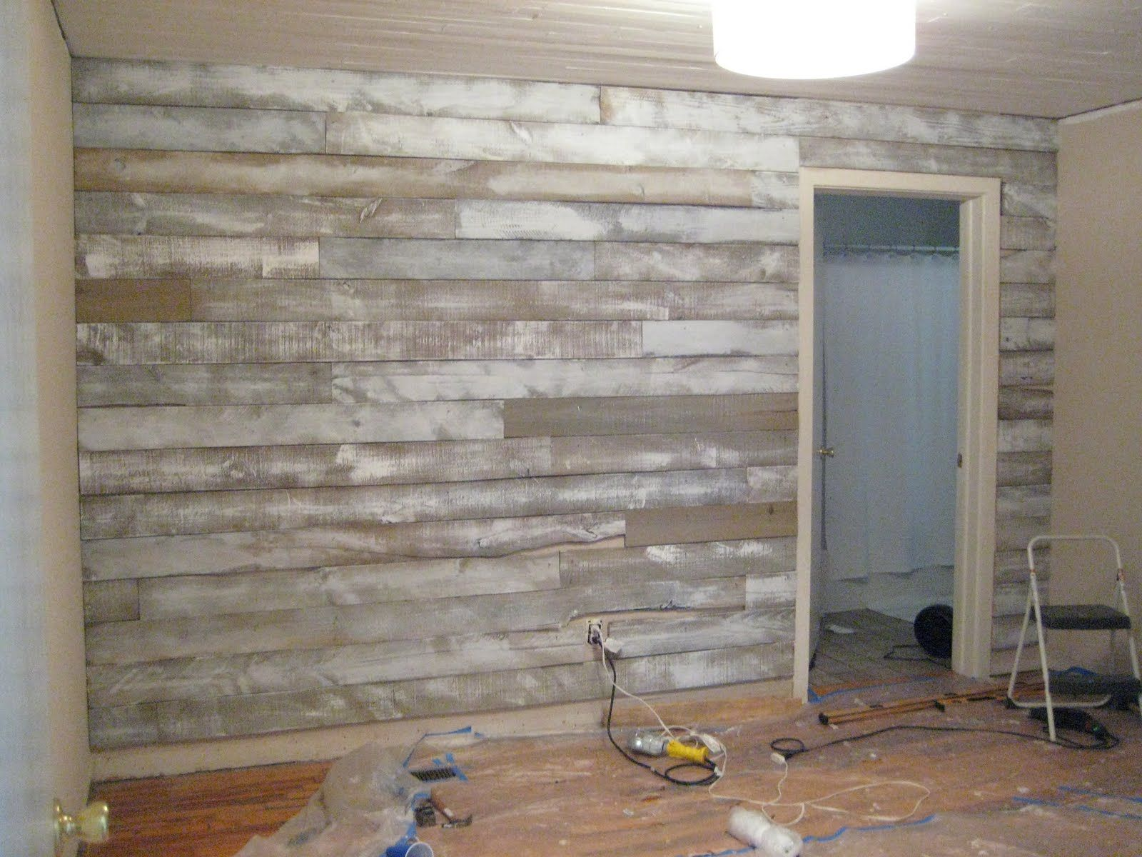 {Wood Accent Wall} After being inspired by other reclaimed wood accent walls,  we
