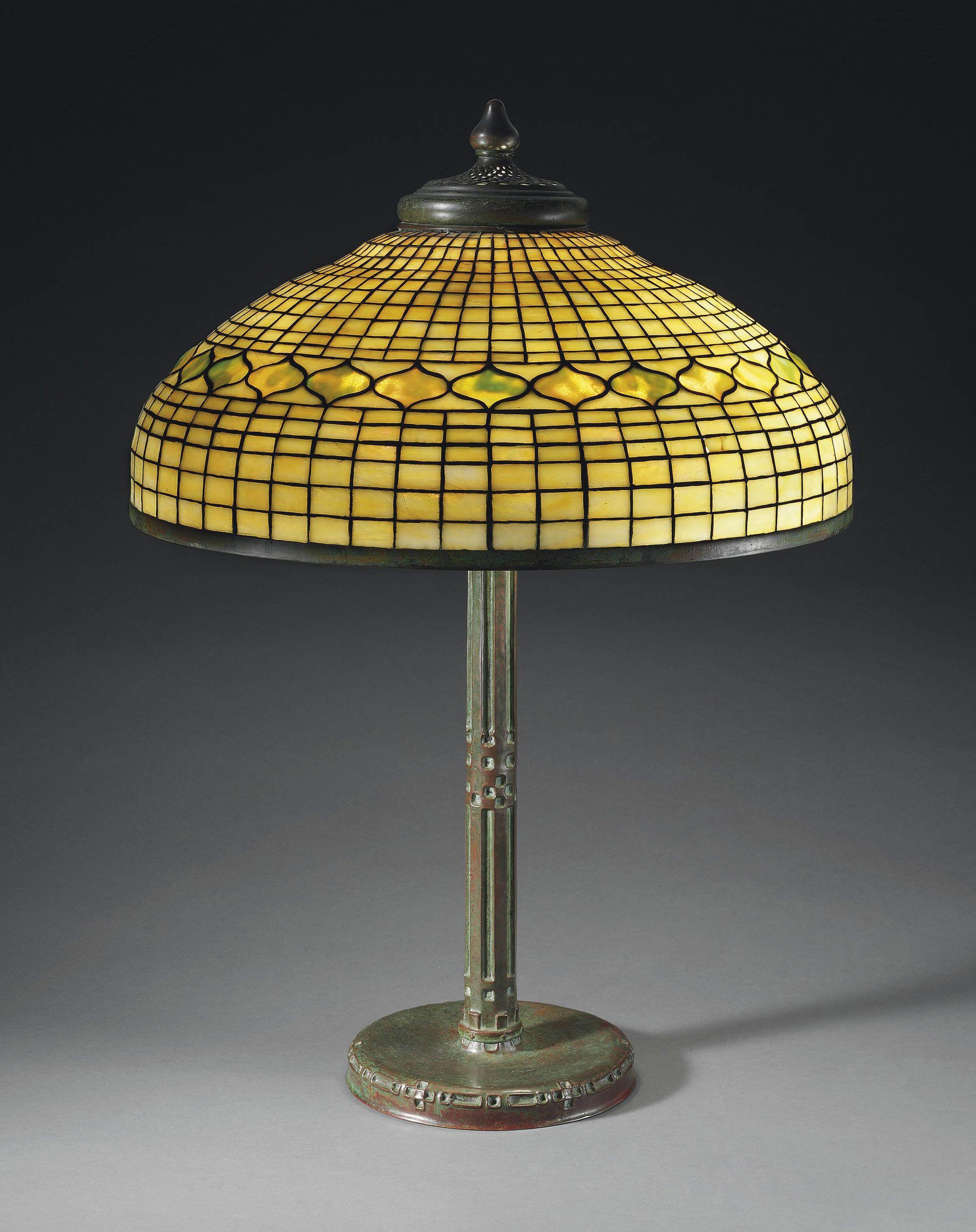 Tiffany Studios A Vine Border Leaded Glass And Bronze Table Lamp Circa 1910