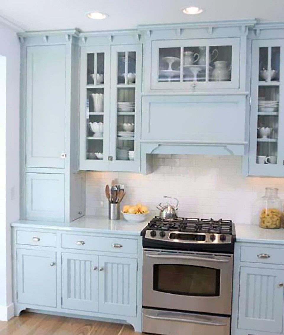 Small Range Hood With Freestanding Oven Stove Ideas In Charming Blue Kitchen And Glass Cabinet Door