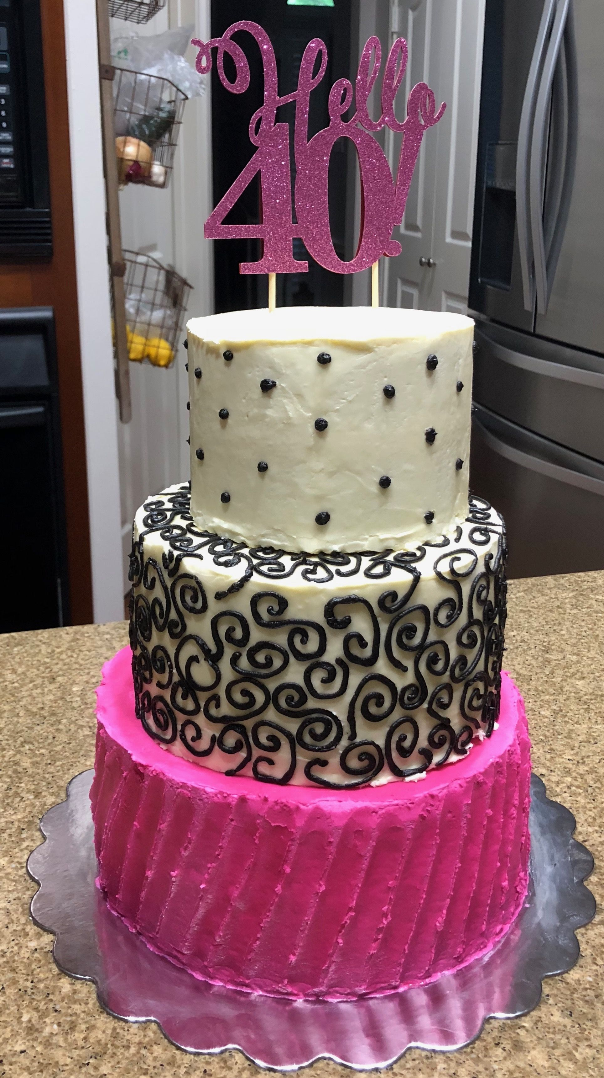 Black white and pink 40th tiered buttercream cake