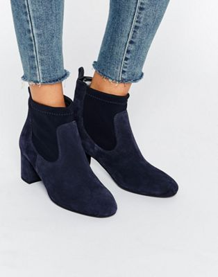Shop Faith Briony Navy Suede Heeled Sock Boots at ASOS.