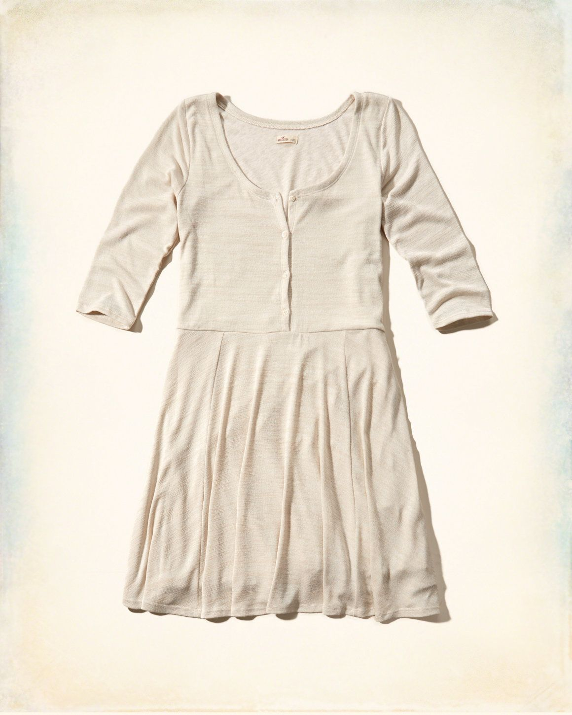 Supersoft and drapey knit with button closure at front, Imported