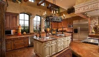 Beautiful Tuscany style kitchen.  The Tuscan kitchen is considered the gathering spot.  The great room used to be the hub of the Tuscan home, with a huge center hearth.  They used to cook in that space, and keep warm in cold temperatures outside.  The kitchen is the gathering spot in today's Tuscany style design.