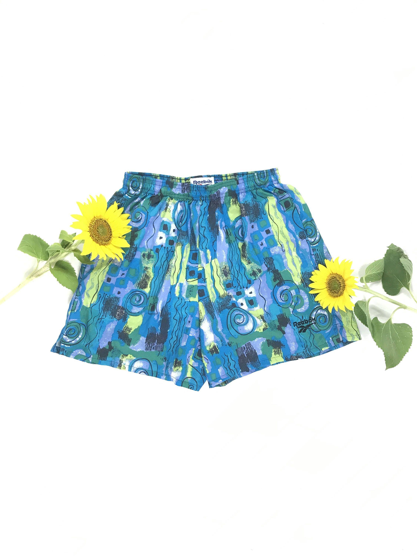 1f79eab75a8e5 1990s REEBOK swim trunks, 90s surf shorts, vintage Reebok shorts, abstract  print swimsuit, mens swim shorts, multicolored bathing suit by  JoyDestroyVintage ...