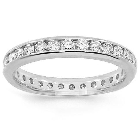 This elegant womens diamond eternity band is crafted in 14K white gold. Small round cut brilliant diamonds are channel set all the way around the band and total to 1.25 carats. The band measures to 1/8 inches in width and weighs approximately 3.2 grams. $1,957.00