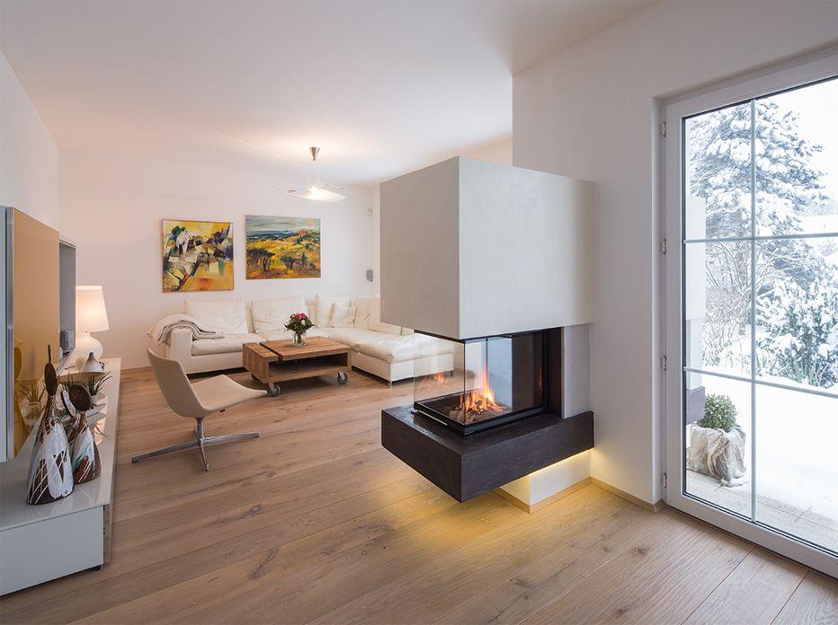 Heizkamin mit Glattspachteloberfläche Ofenbau Kummer GmbH - wohnzimmer mit offener küche