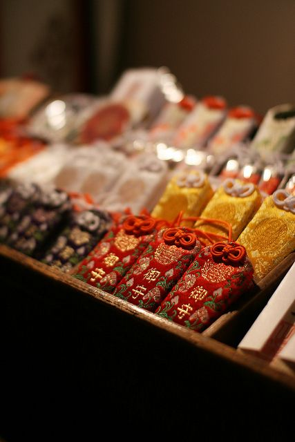 Omamori - Omamori is a Japanese amulet commonly sold at religious sites and is dedicated to particular Shinto deities as well as Buddhist figures. It serves to provide various forms of luck and protection.