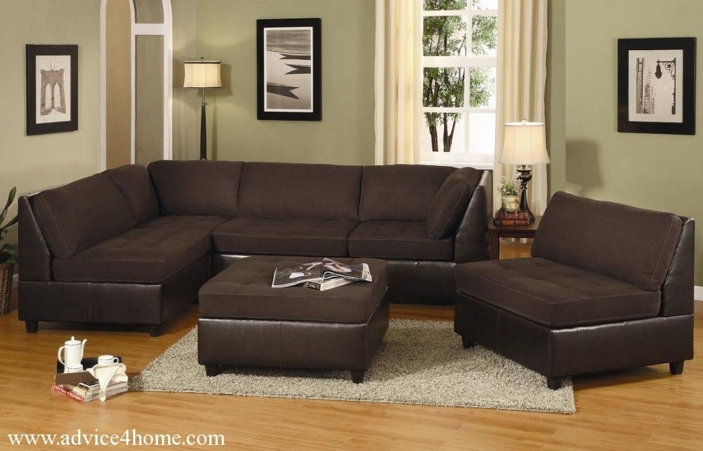 Dark Sofa On Light Carpet With Green Walls This Is A