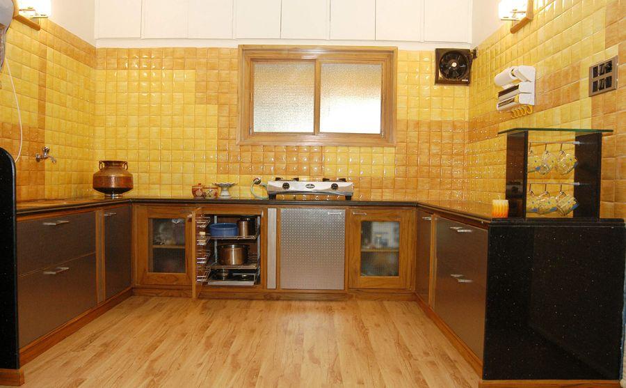 Kitchen Tiles Colour As Per Vastu modern yellow kitchen with wooden flooring, designinterior