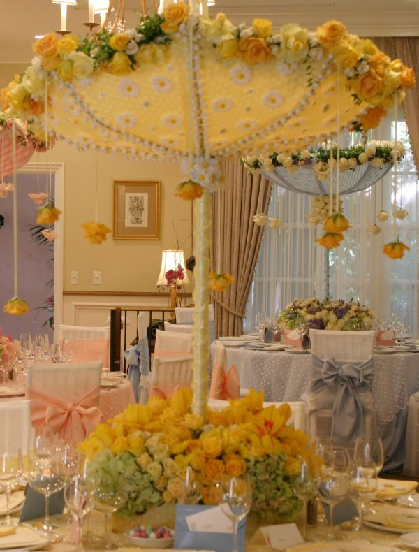 Umbrella baby shower or easter tables it 39 s a bit much for Baby shower umbrella decoration ideas