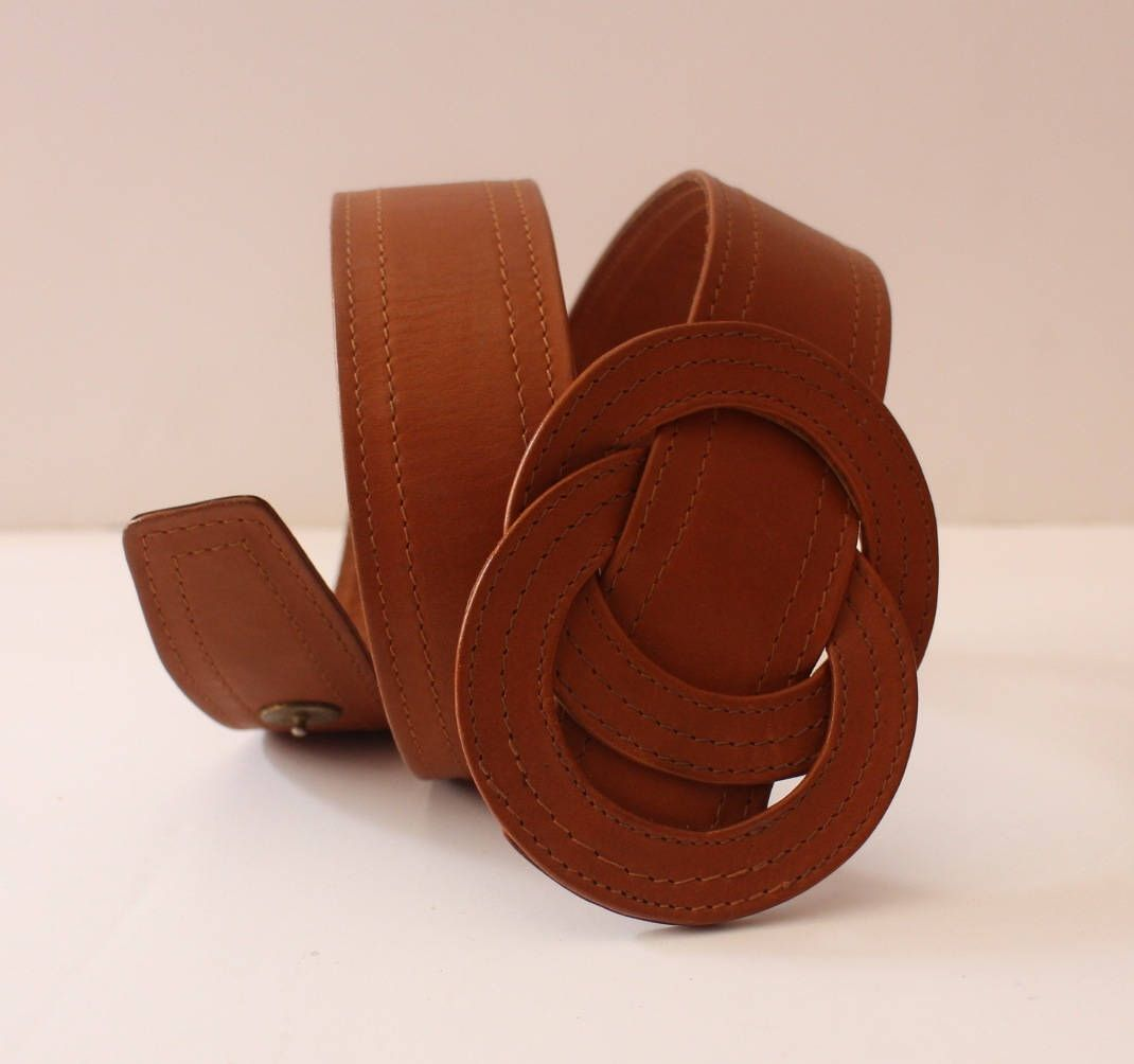 Brown/condition new/closure with button pressure/beautiful loop/beautiful quality leather belt