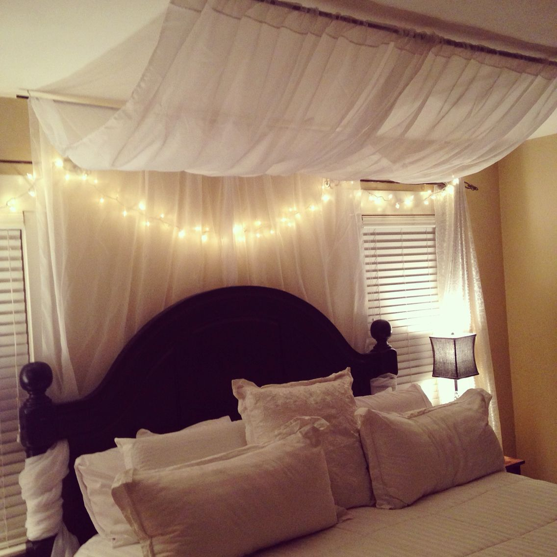 "DIY bed canopy using two ""scarf"" curtain panels from"