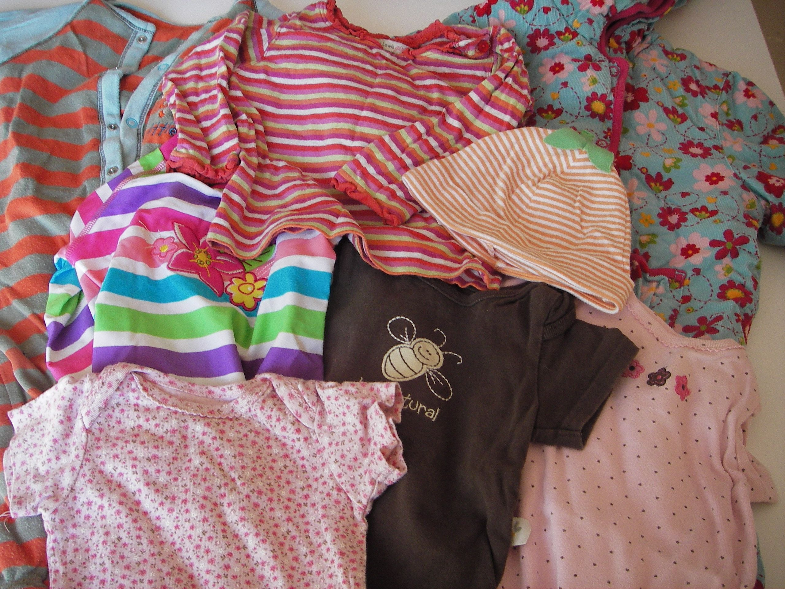 Here's a bundle of Jesse's gorgeous outfits that she's out grown - from quilted all-in-ones to swim suits x