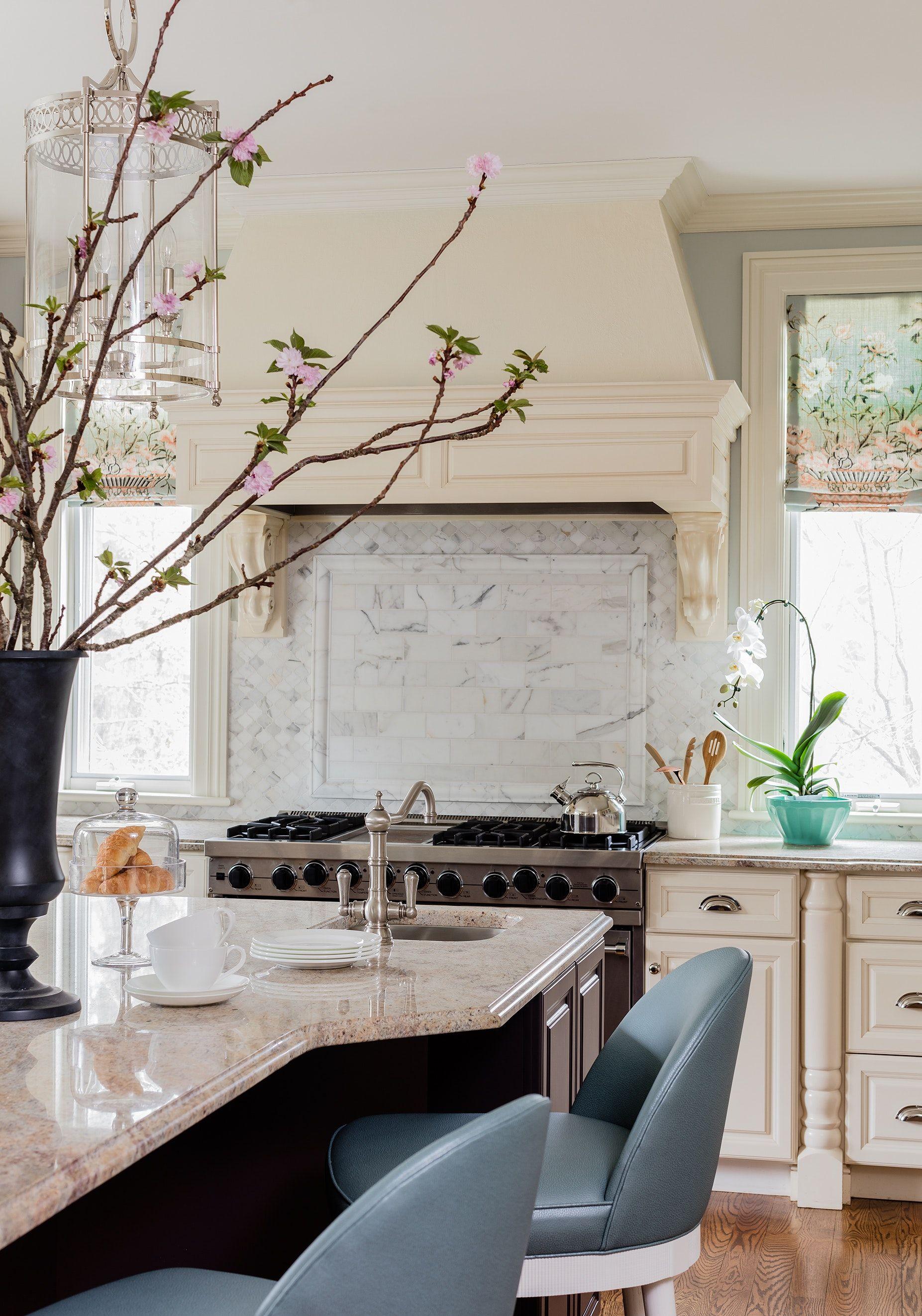 Transitional kitchen with carrara backsplash and blue leather ...