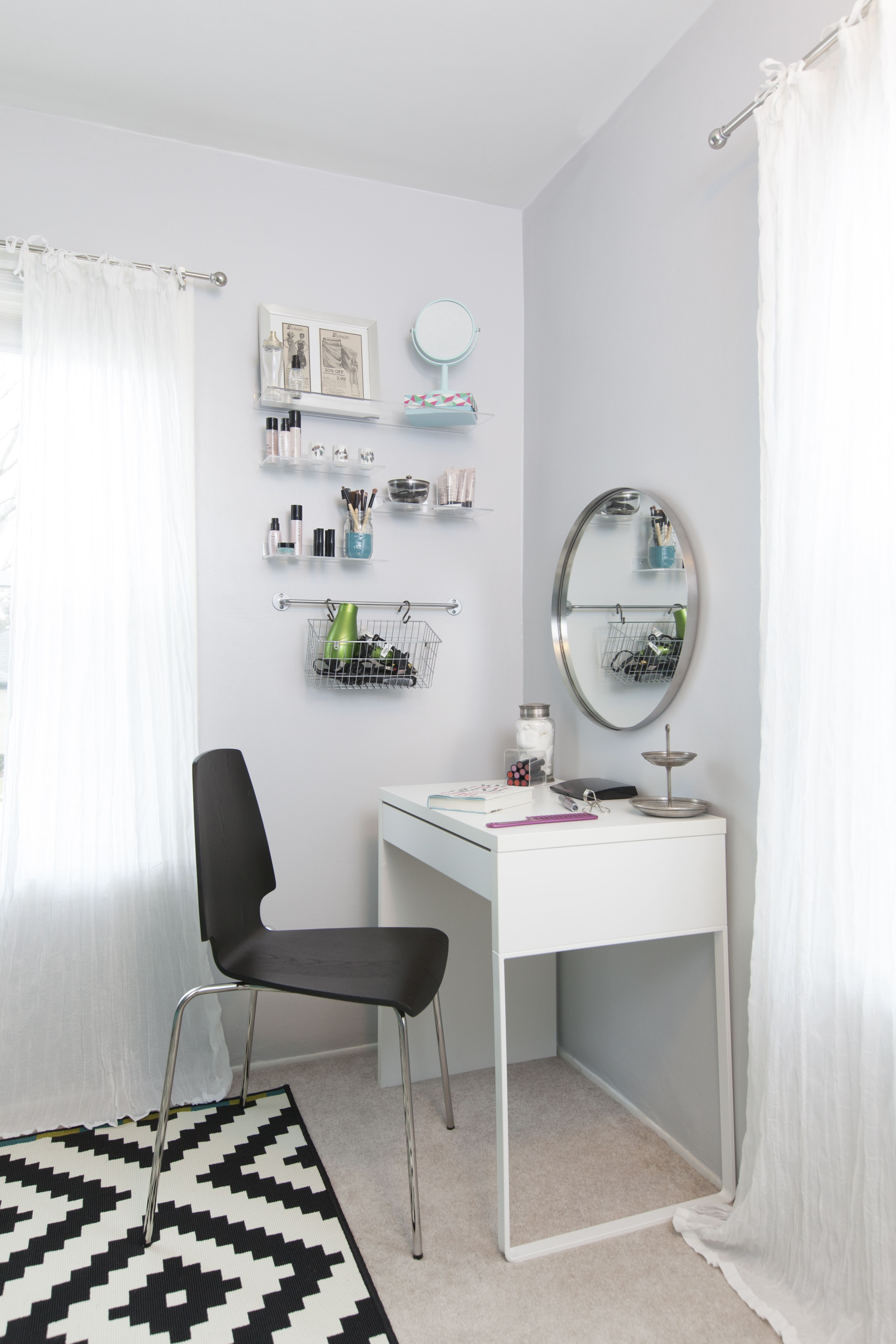 Vanity area featuring micke desk vilmar chair and acrylic shelves