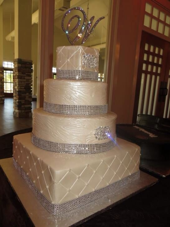 We love the diamond initial on top of this gorgeous wedding cake
