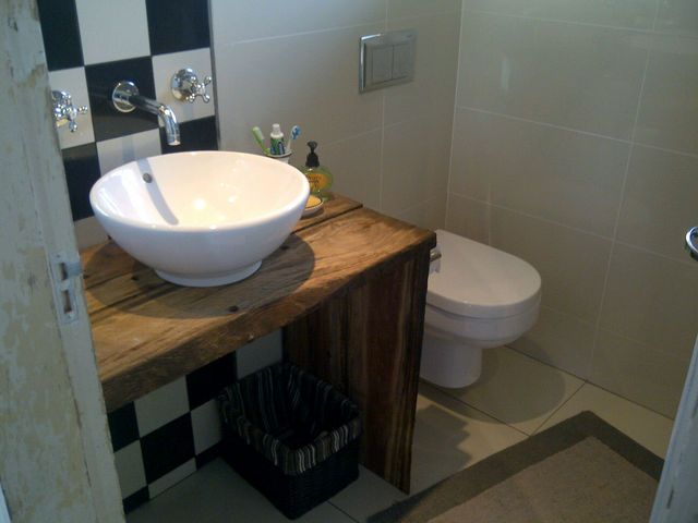 Bathroom Vanity Was Made From Railway Sleepers The Checkered Tiles Were Incorporated To Age Decor Fit In With Old Building