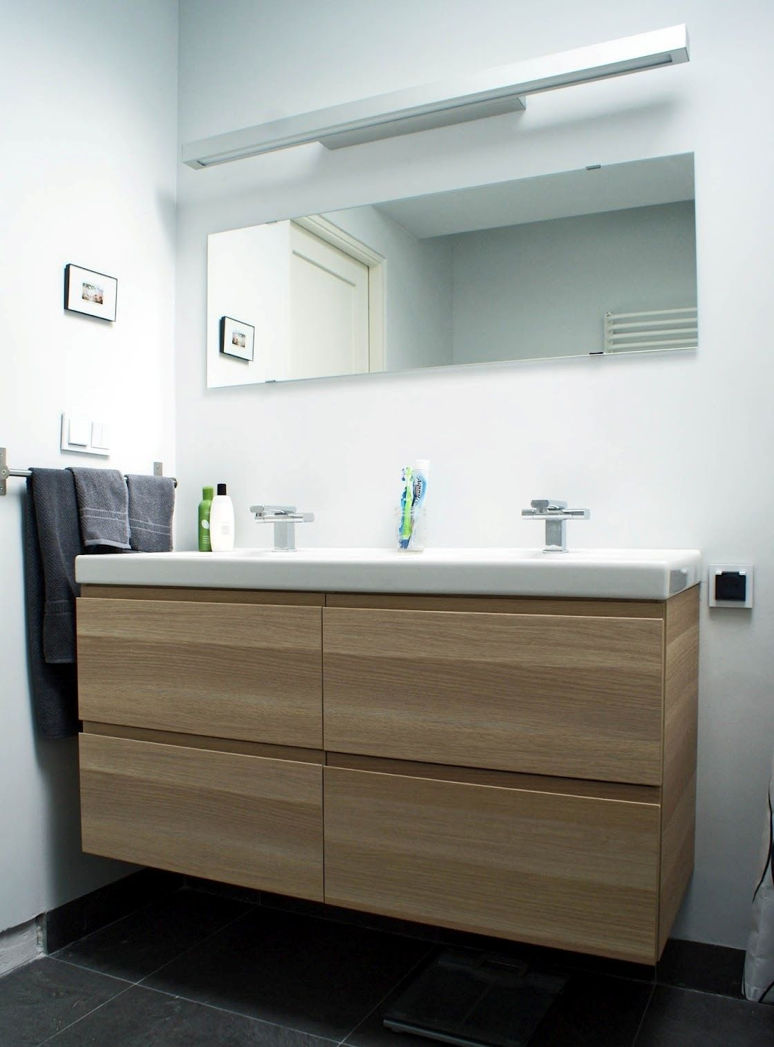 If the vanity doesn't go to the wall, hang a towel rail