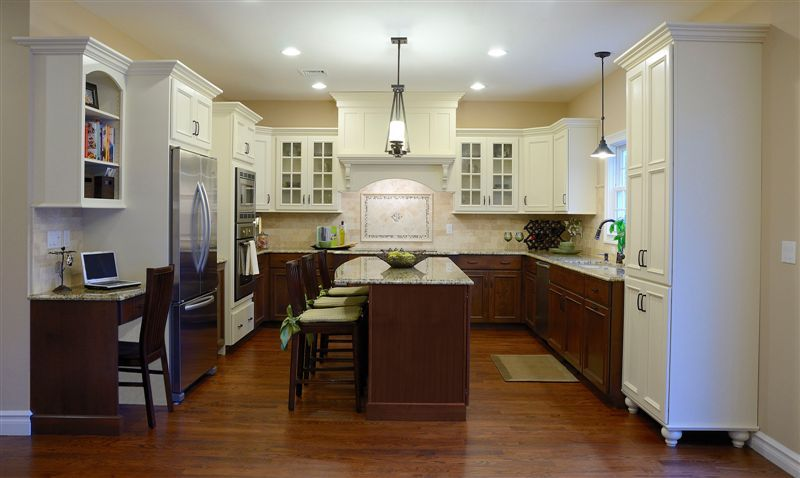 Example Of Upper Cabinets Painted White, Lower Cabinets Stained Darker,  Light Counters, Wood Floors