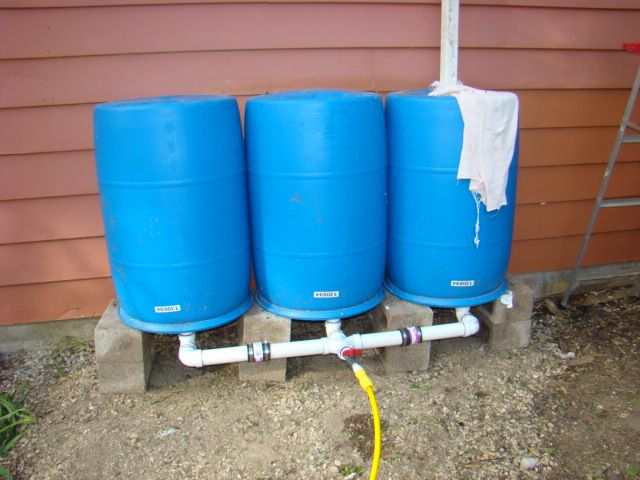 How To Daisy Chain And Install Multiple Rain Barrels Rain Barrel Rain Water Collection System Rain Water Collection