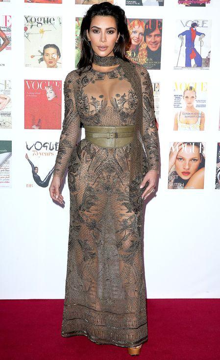 Kim Kardashian in an olive green sheer Roberto Cavalli dress