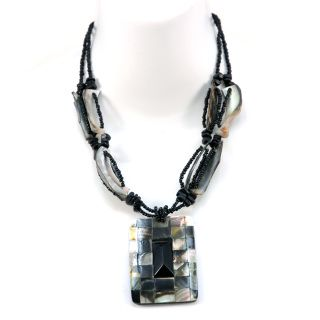 """- Add some culture to your style with this islander inspired shell necklace - Shell beads and colored seed beads ties this piece of jewelry together vibrantly - Necklace is finished with a Iridescent shell tiled charm with a black stone center for a subtle shine - Light in weight - Necklace end to end length is 16 inches  - Charm approximate dimension is 1.75""""W x 2.5""""H - Clasp at the end"""