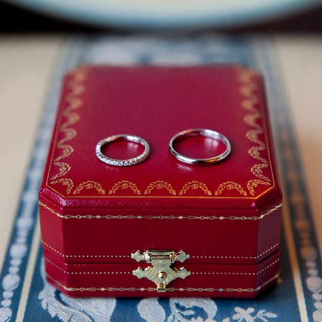 The Couple S Wedding Rings Sit On Their Cartier Box