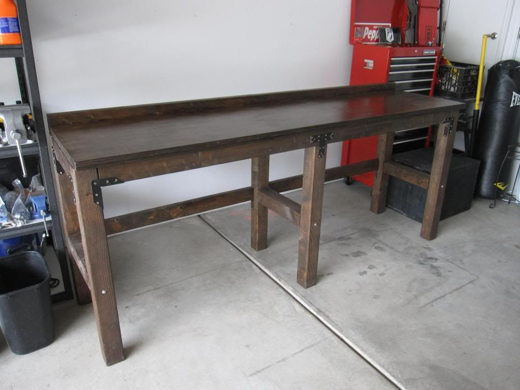 Wood Workbench With Metal Brackets And Stain