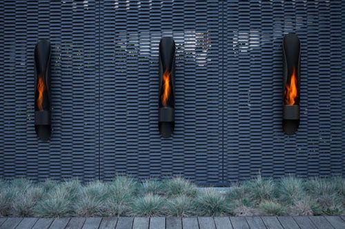 Black Steel Outdoor Fireplace Design by Acquaefuoco