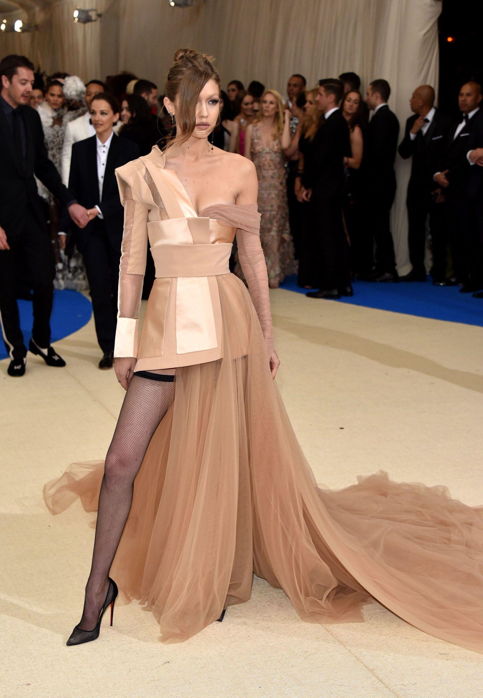 Gigi Hadid Wears a Nude, Tommy Hilfiger Cinderella Dress to the Met ...