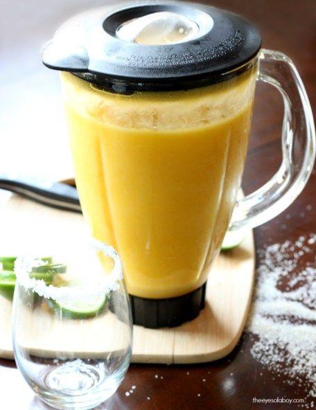pitcher of frozen mango margarita drink recipe #frozenmargaritarecipes
