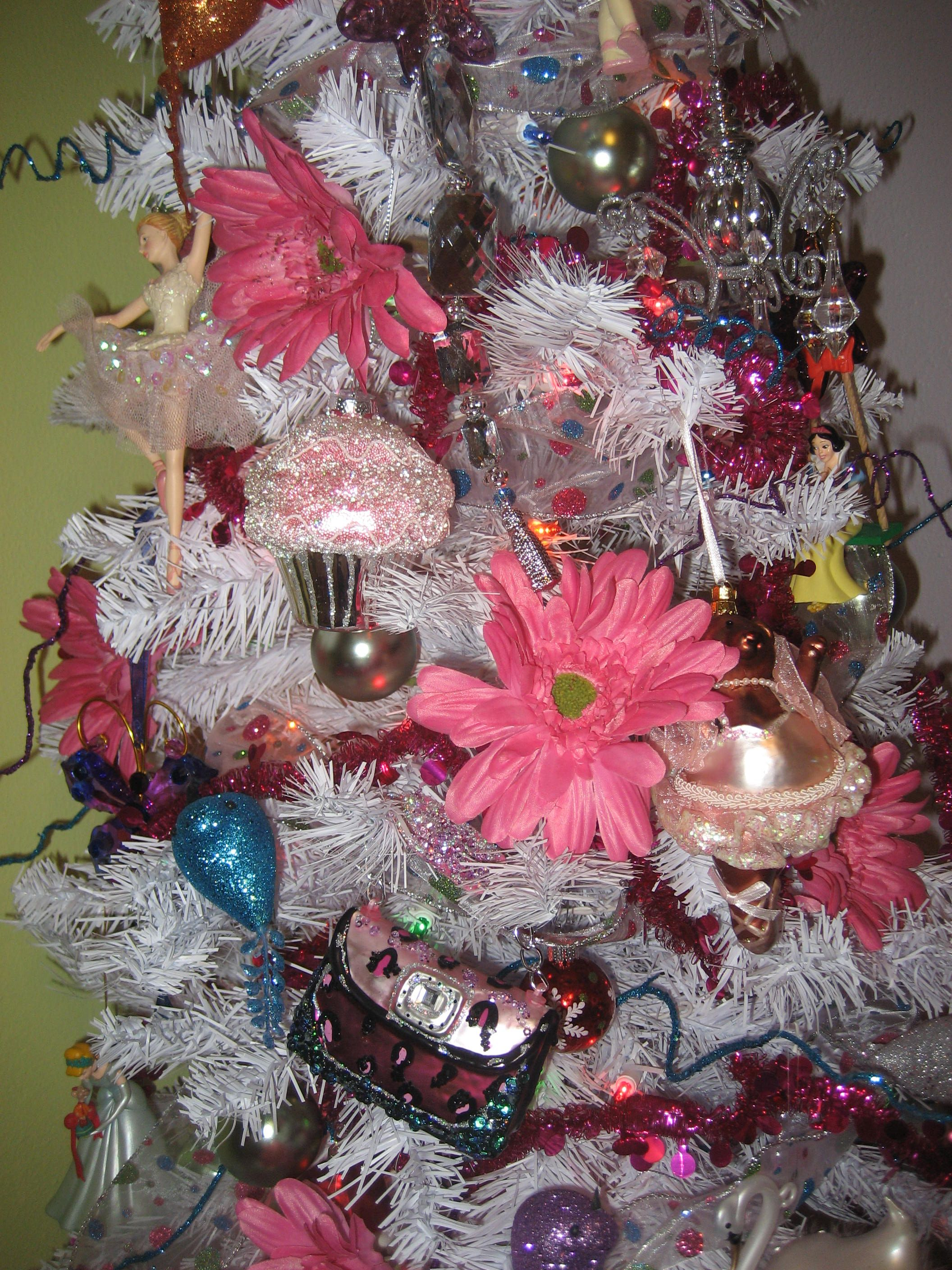 """Close up of all things """"girlie"""" pink Christmas tree."""