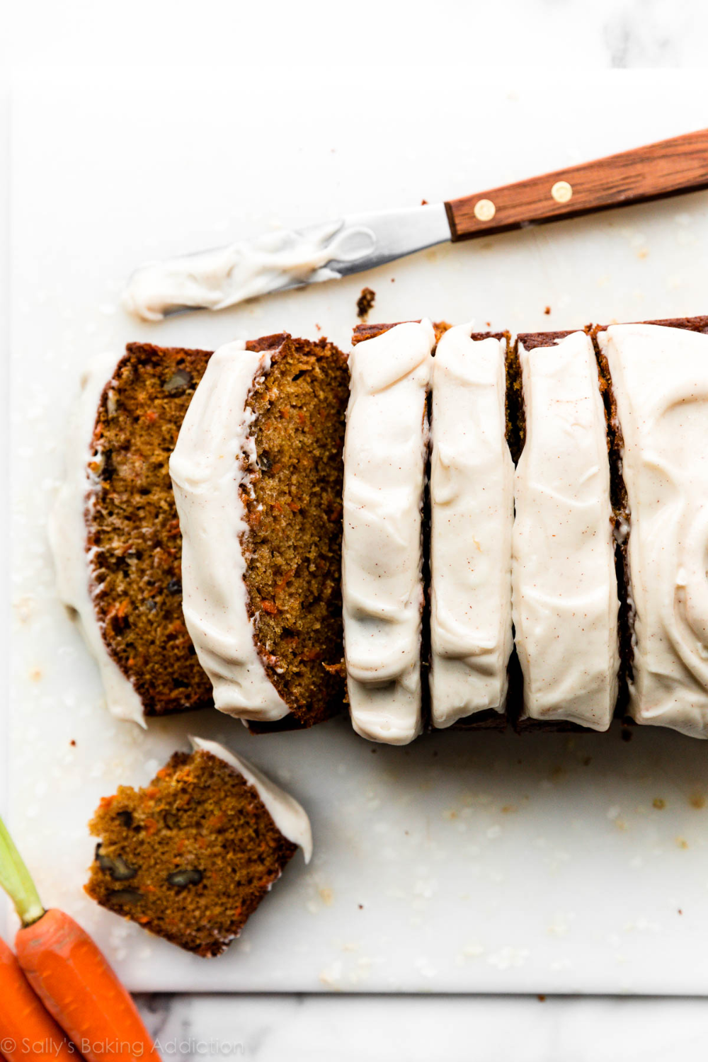 super moist and flavorful carrot cake in the form of quick bread this carrot cake loaf is quick e in 2020 carrot cake loaf carrot cake cinnamon cream cheese frosting pinterest