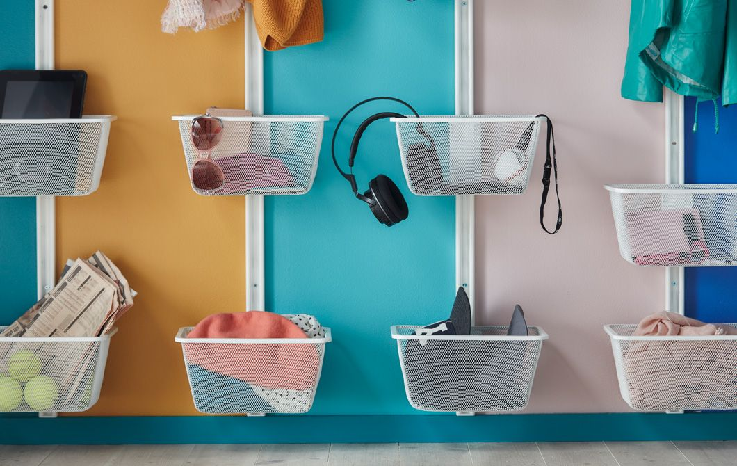 Get organised with baskets on the wall for different family members ...