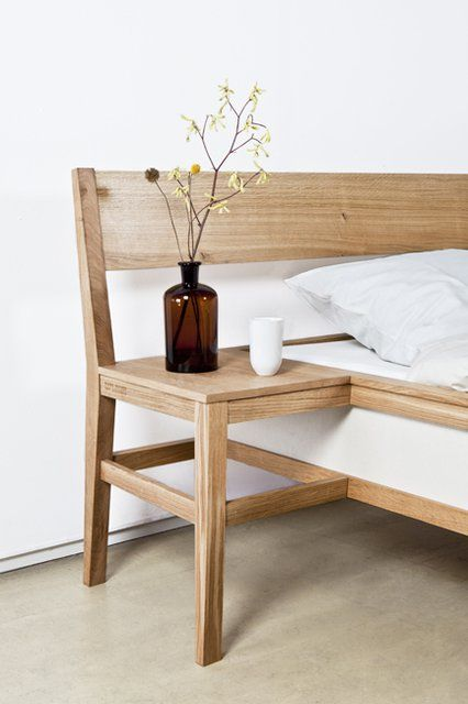 Wow, that's like, ingenious.  Chair/side table built in with the bed and head board, wow, seriously awesome.  Needs a shelf or drawer under the chair to be perfect use of space! Love this idea. Would need to be a DIY project. Further info for this sight is no longer available.