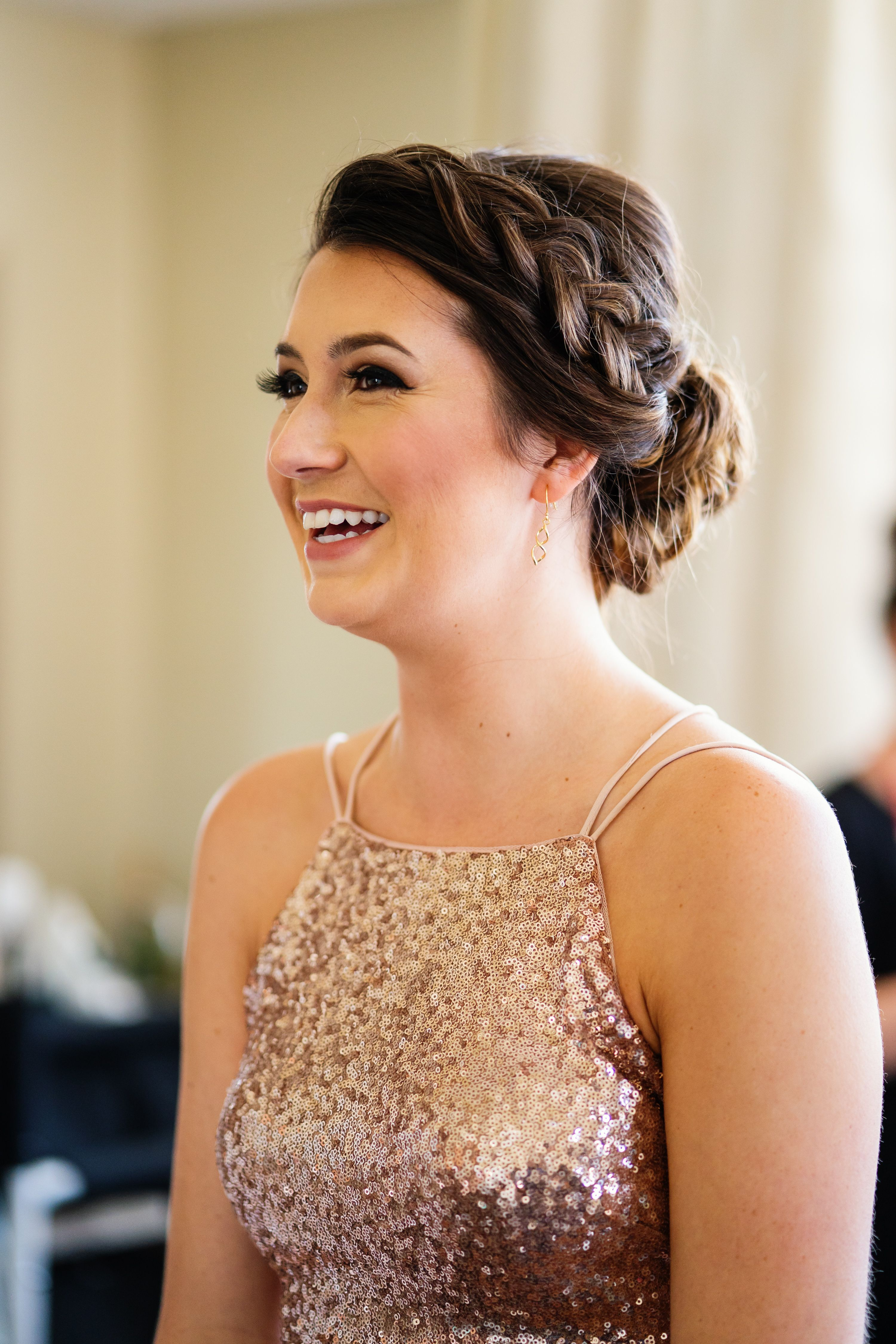 light rose gold makeup with pulled out crown braid in an