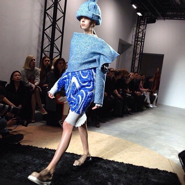 Oversized bobble hats and very square-toed shoes at Acne. MATCHESFASHION.COM #MATCHESFASHION