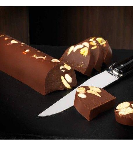 Dark chocolate gianduja log studded with hazelnuts and pistachios A
