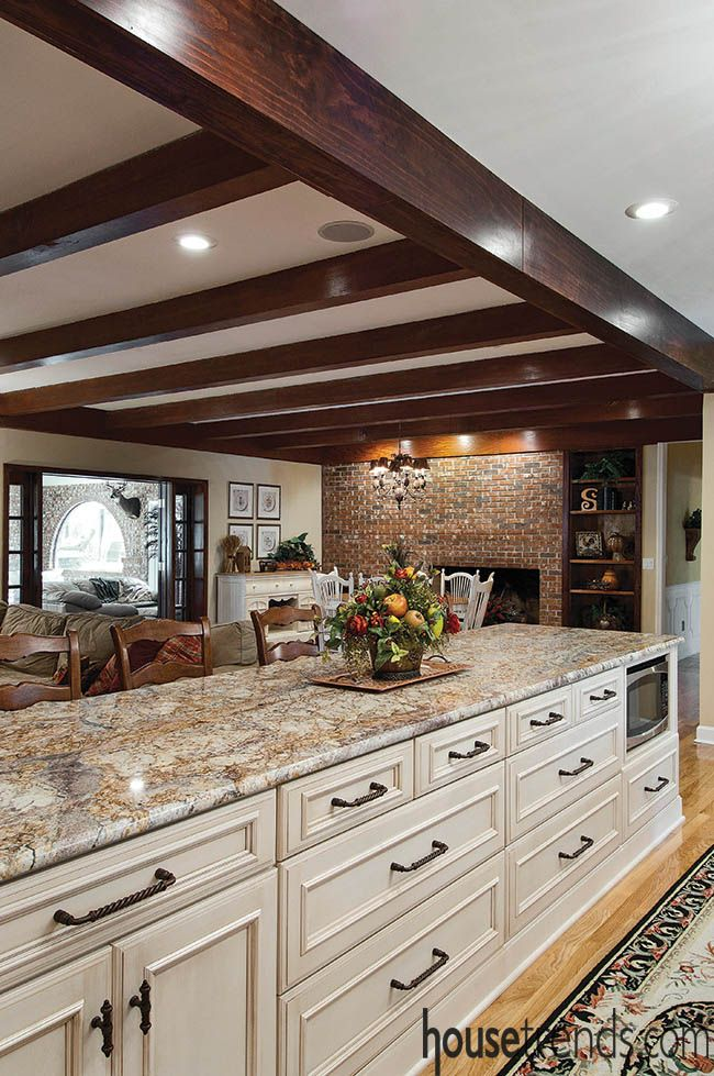 Exceptional This Kitchen Design Overlooks The Nearby Family Room, Which Is Accented  With Thick Wood Ceiling