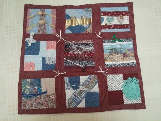 Fidgit quilt, my first one, added old lace, bells, stretch items, buckles, etc