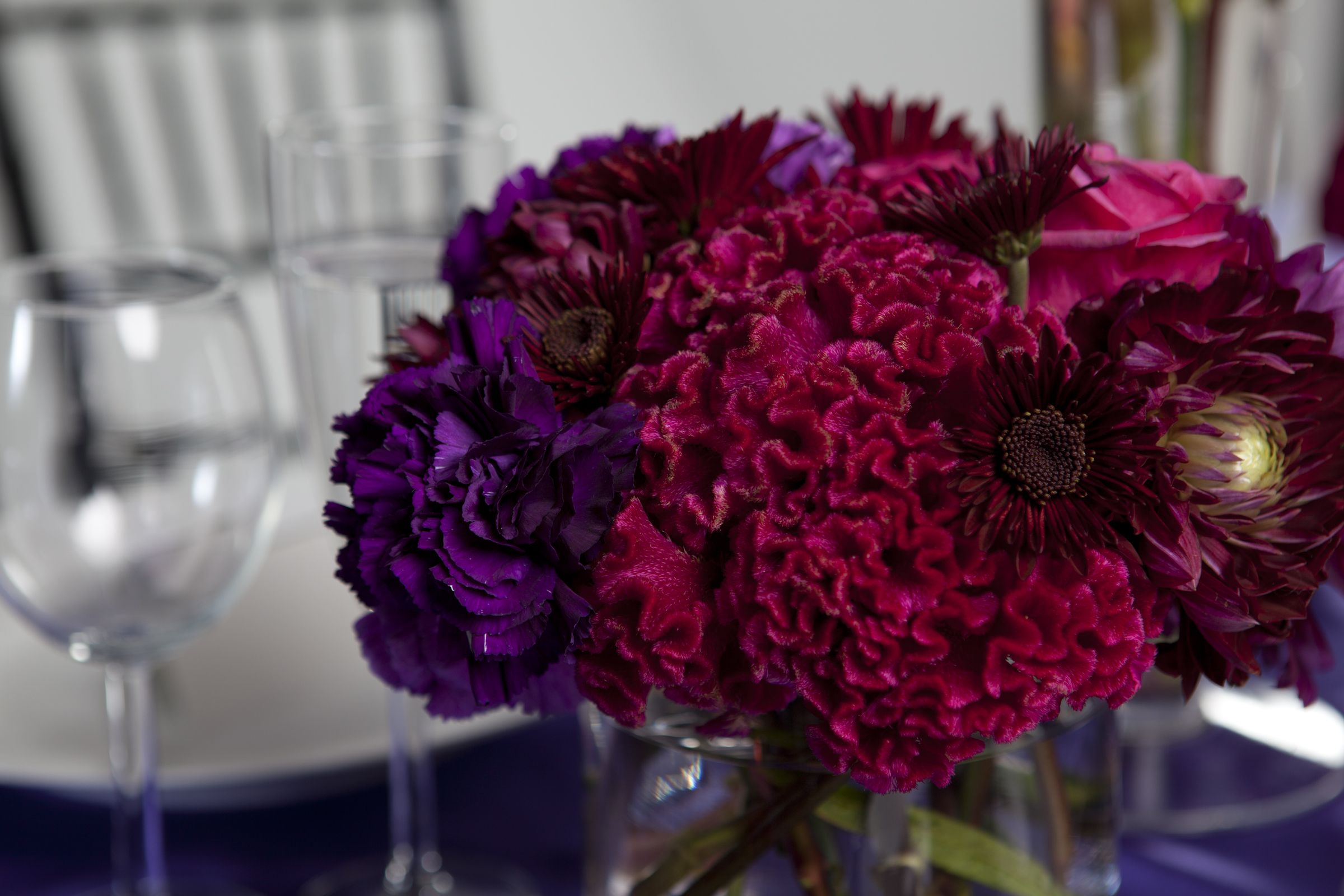 Florals in rich reds and purples jeweled tone colors. www.makiniregaldesigns.com
