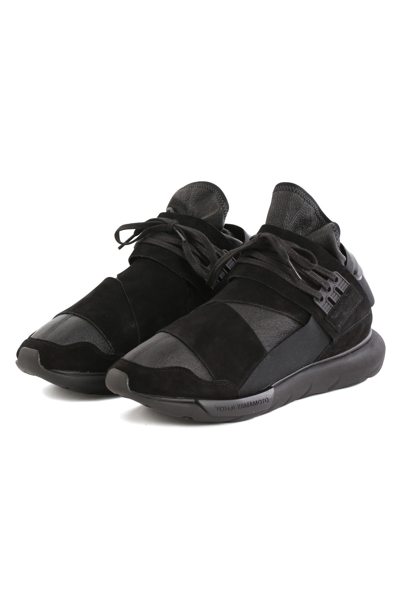 The Qasa High Leather from Y-3, a collaboration between Yohji Yamamoto and adidas. Details Black premium leather. Y-3 logo at back. The new silhouette of these sneakers combines the iconic Y-3 suede s