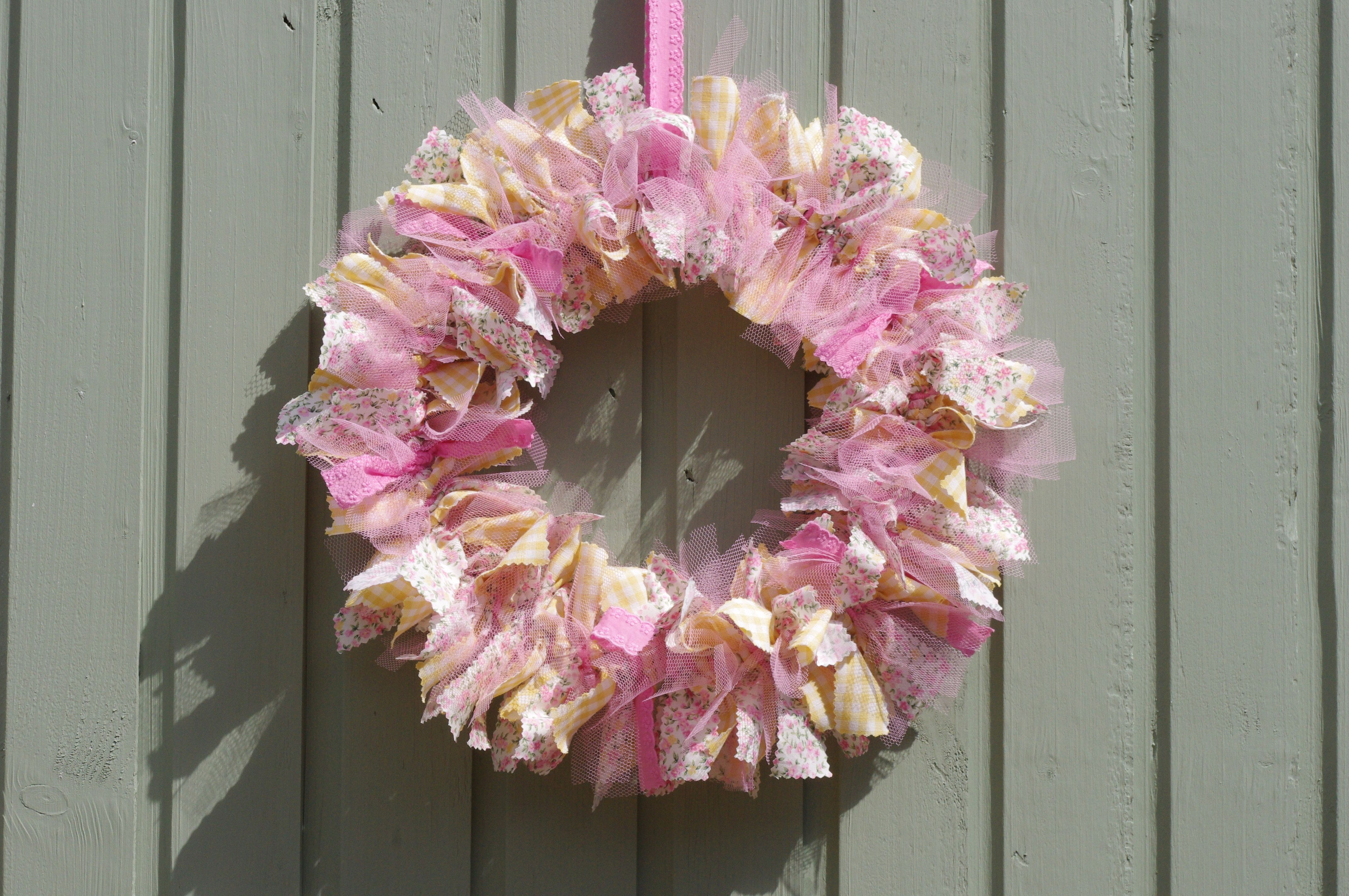Yellow and pink material and tulle wreath.