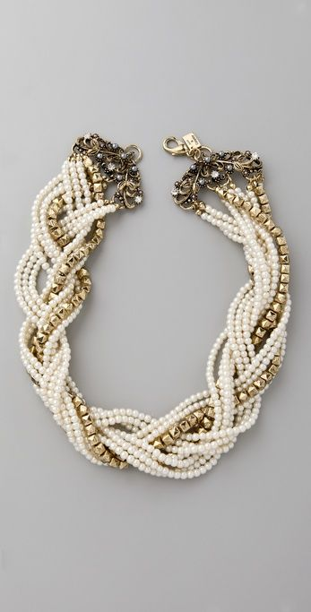 Faux pearls and faceted, antiqued gold-plated beads at the braided strands necklace.