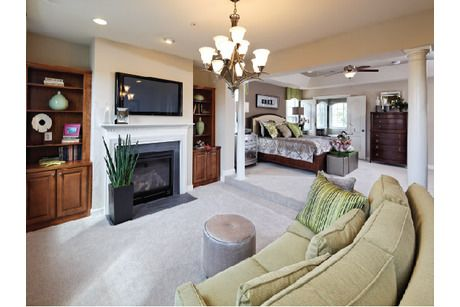 Set Off By Pillars This Sitting Room Adjoining The Master Suite Includes A Fireplace And