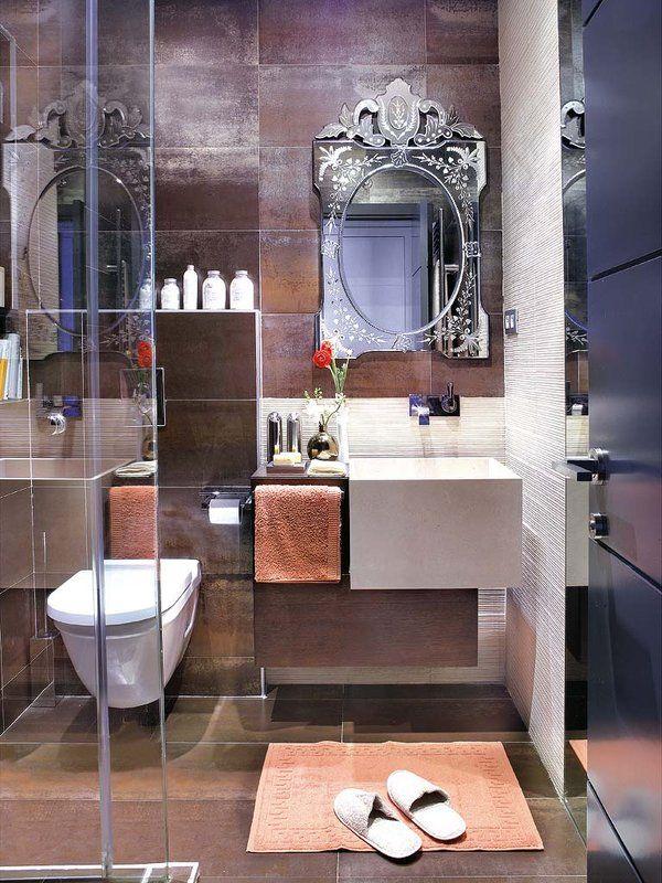 Un baño en tonos chocolate   Espejo redondo para baño ...