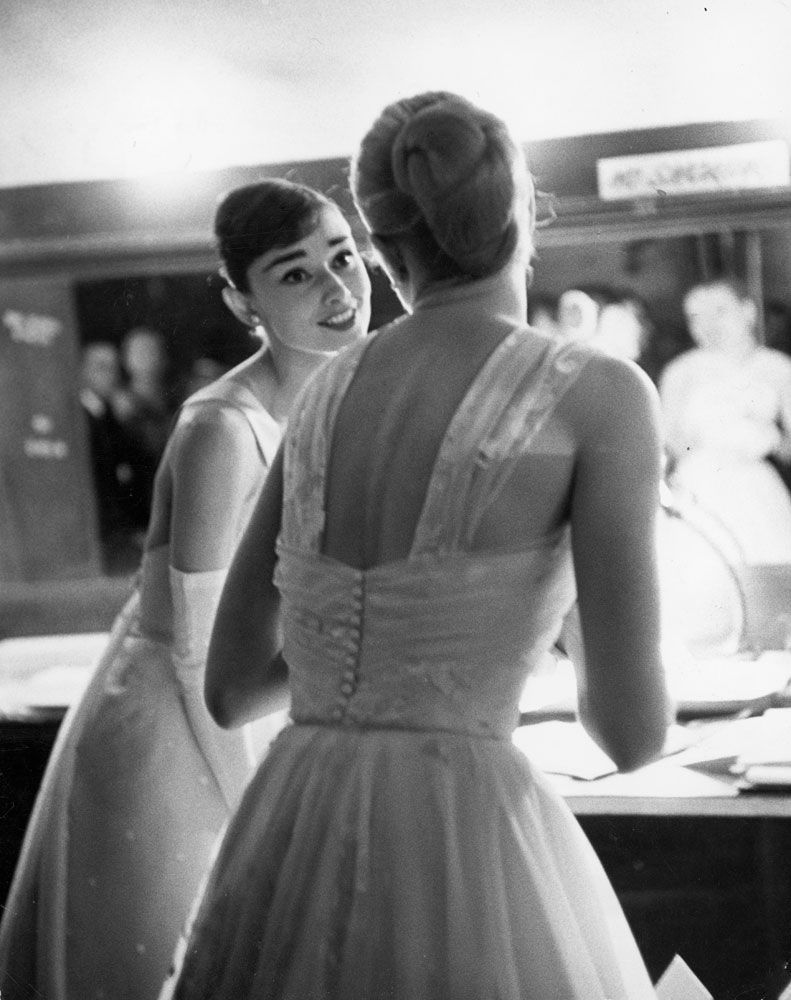Audrey Hepburn and Grace Kelly backstage at the RKO Pantages Theatre during the 28th Annual Academy Awards, 1956