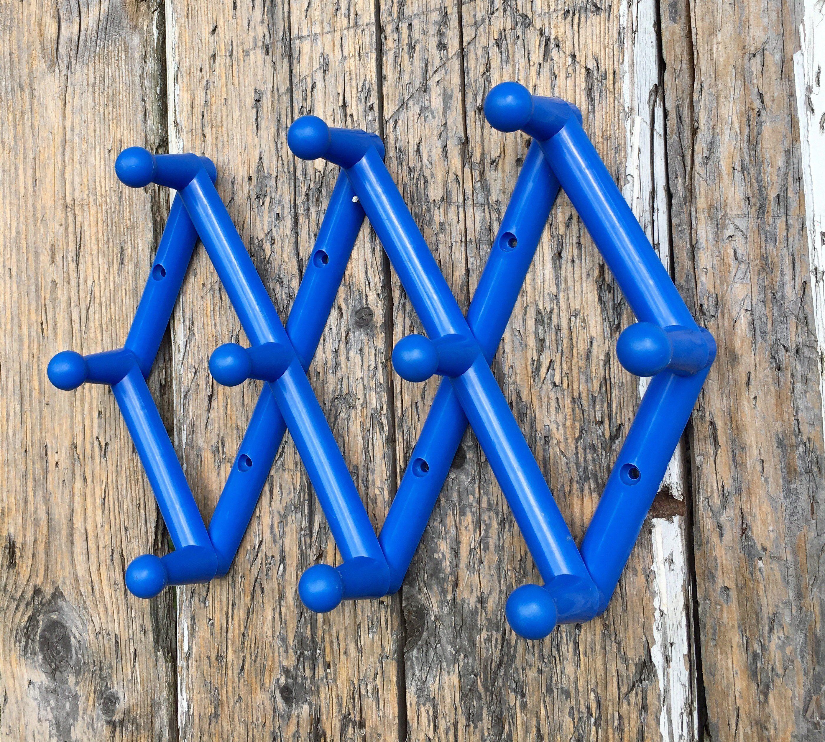 blue plastic accordion wall peg rack