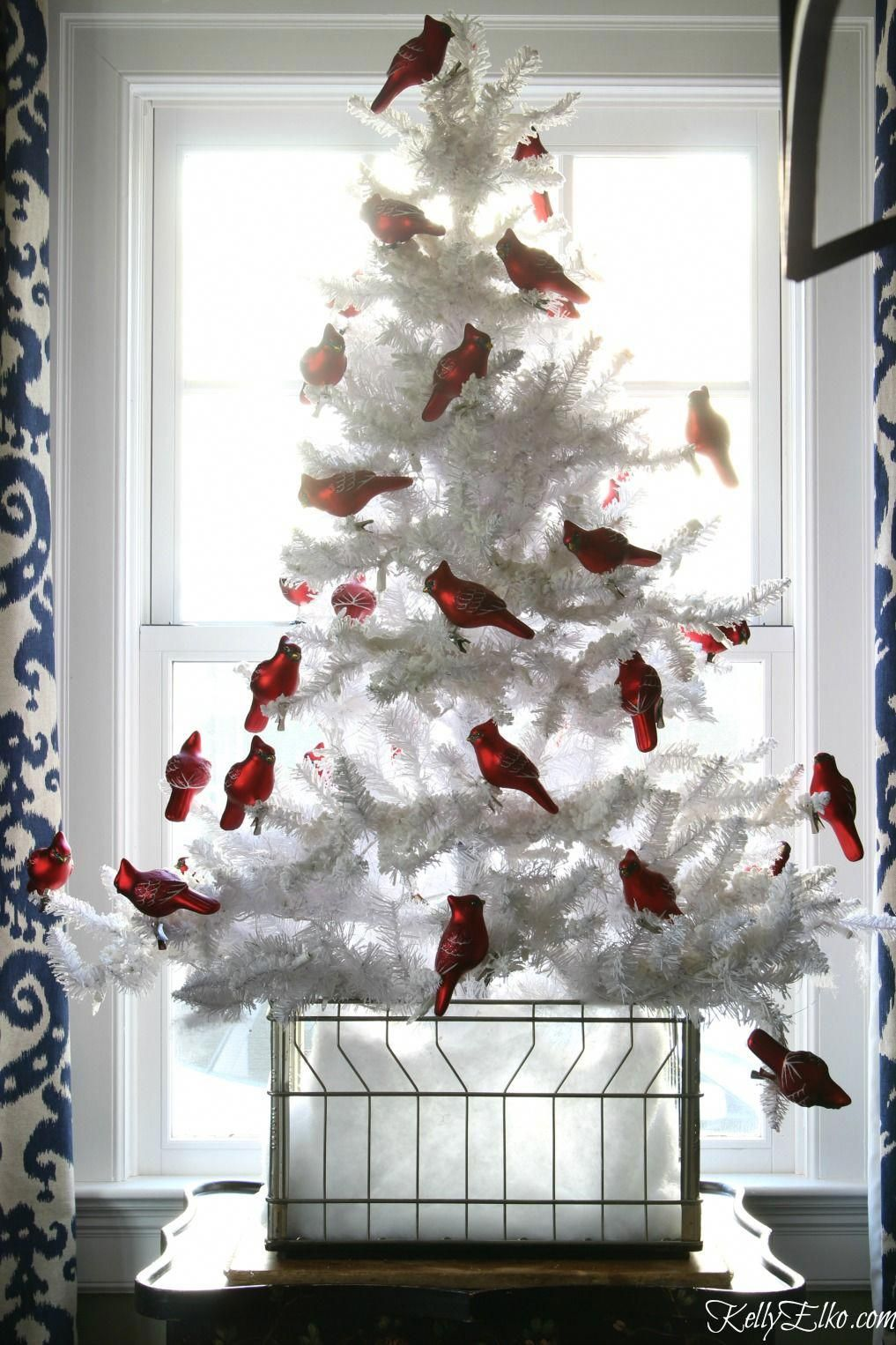 Love this flocked white Christmas tree with a flock of red cardinal ...