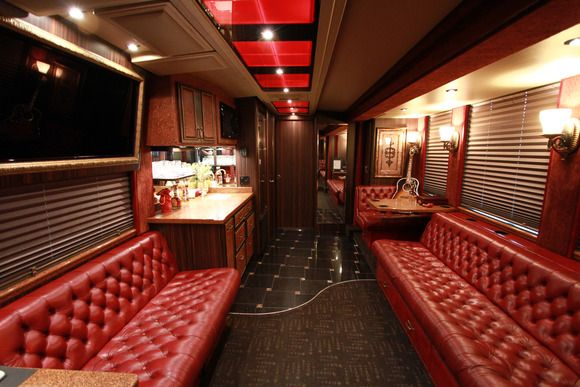 Interior john rich 39 s bus features a cool living room and for Inside homes rich famous